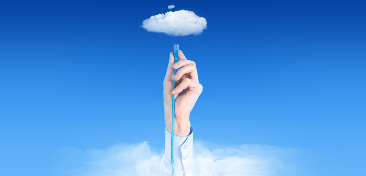 Cloud computing concept with hand plugging cord into cloud